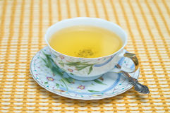 Green tea in a cup. Cup of green tea on a table-cloth (focus on a cup royalty free stock photo