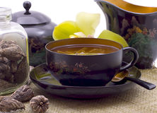 Green tea cup. Green tea in beautiful black cup, devices and flower Stock Image