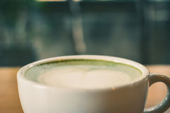 Green tea cup in cafe shop time to relaxing Royalty Free Stock Photo