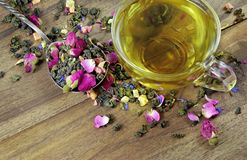 Green tea. cup of green tea with flowers and fruit pieces. blend tea. top view. Green tea. cup of green tea with flowers and fruit pieces. blend tea royalty free stock images