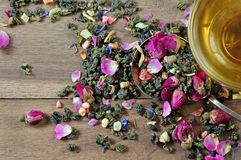 Green tea. cup of green tea with flowers and fruit pieces. blend tea. top view. Green tea. cup of green tea with flowers and fruit pieces. blend tea stock images