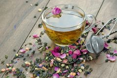 Green tea. cup of green tea with flowers and fruit pieces. blend tea. top view. Green tea. cup of green tea with flowers and fruit pieces. blend tea stock photo