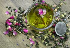 Green tea. cup of green tea with flowers and fruit pieces. blend tea. Close-up royalty free stock photos