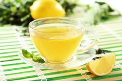 Green tea in cup on napkin Stock Photography