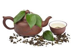 Green tea in cup and pot isolated. Over white Stock Photo