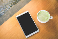 Green tea cup and tablet in cafe shop time to relaxing Royalty Free Stock Image