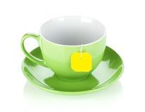 Green tea cup and teabag Stock Photos
