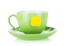 Green tea cup and teabag Royalty Free Stock Images