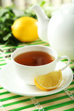 Green tea in cup and teapot on napkin Royalty Free Stock Image