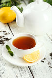 Green tea in cup and teapot on white wooden background Royalty Free Stock Photo