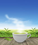 Green tea cup on wooden floor background Royalty Free Stock Photos