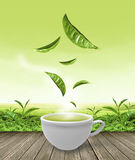 Green tea cup on wooden floor background Royalty Free Stock Images