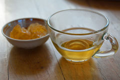 Green tea. A cup of tea and yellow sugar on the wooden table Royalty Free Stock Photos