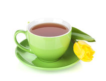 Green tea cup and yellow tulip Stock Photography