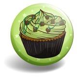 Green tea cupcake on round badge Stock Photos