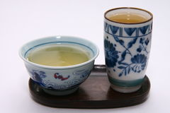 Green tea and cups Stock Photography