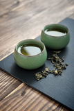 Green tea in cups Royalty Free Stock Images