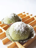 Green Tea Dessert. Green Tea with white sugar topping cake with a ladder wood as background Stock Photography