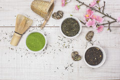 Green Tea. Different types of Japanese green tea leaves and powder green tea, in tea bow Royalty Free Stock Photography