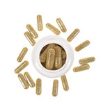 Green tea extract capsules with container Royalty Free Stock Photography