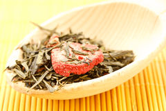 Green tea flavored with dried fruits Stock Image