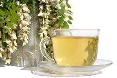 Green tea and flowers acacias Stock Image