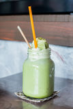 Green tea frappe and blended. On table Royalty Free Stock Image