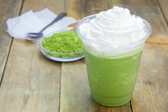 Green tea frappe in plastic cup. Homemade green tea frappe in plastic cup stock image
