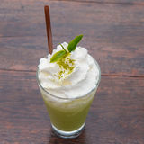 Green tea frappe. On the table royalty free stock photography