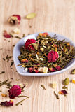 Green tea with fruits, spices, rose petals Royalty Free Stock Images