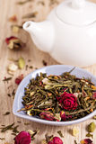 Green tea with fruits, spices, rose petals Stock Images