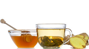Green tea, ginger and honey over white background royalty free stock images