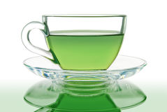 Green tea in a glass bowl on a white background Stock Photos