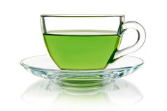 Green tea in a glass bowl on a white background Stock Images