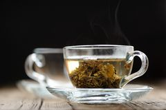 Green tea in glass cup with steam Royalty Free Stock Photo