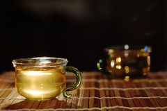 Green tea in a glass cup Stock Photos