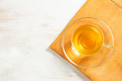 Green tea in glass cup on the wooden background Royalty Free Stock Photos