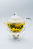 Green tea in glass teapot Royalty Free Stock Photo