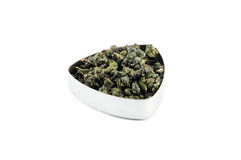 Green tea. High quality Oolong green tea from Indonesia, in a metal container Royalty Free Stock Photo