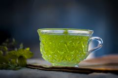 Green tea of holy basil,Ocimum tenuiflorum,tulsi for weight loss and skin care. Royalty Free Stock Photo