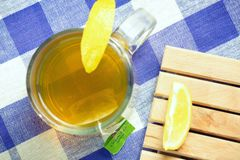 Green tea hot drink and lemon Royalty Free Stock Photo
