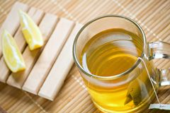 Green tea hot drink and lemon Stock Photo