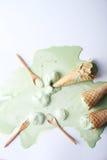 Green tea ice cream cones dropped Stock Photography