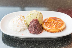 Green tea ice-cream with pancake ,red bean and whipping cream Royalty Free Stock Photography
