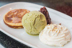 Green tea ice-cream with pancake ,red bean and whipping cream. Dessert royalty free stock photos