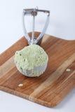 Green tea ice cream in scooping utensil Stock Photos