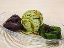 Green tea ice cream. Served with red bean and Japanese mo-chi Stock Photos