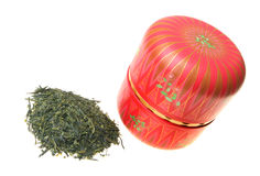 Green tea with Japanese caddy. Japanese green tea leaf with red tea caddy isolated on white background Royalty Free Stock Photos