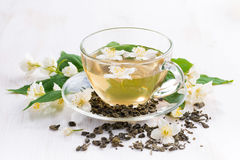 Green tea with jasmin in glass cup Stock Image