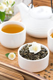 Green tea with jasmine and kettle of freshly brewed tea Stock Photos